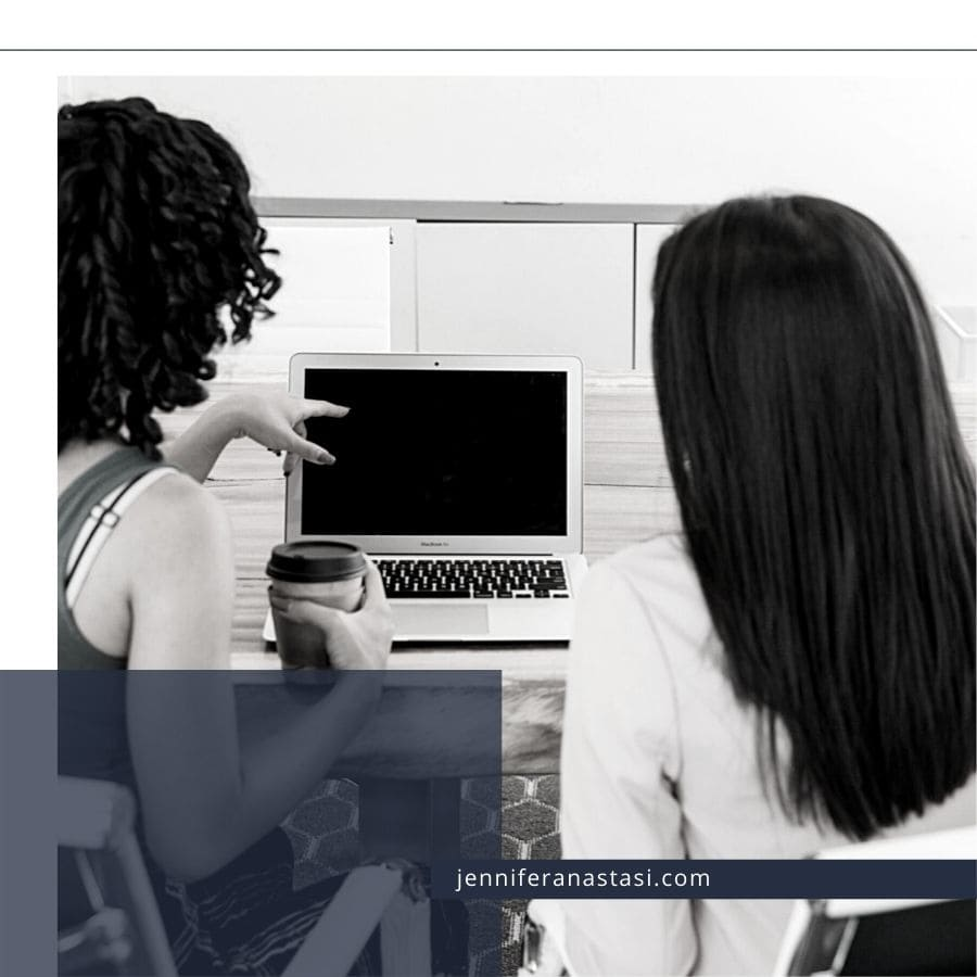 Two women looking at a laptop computer
